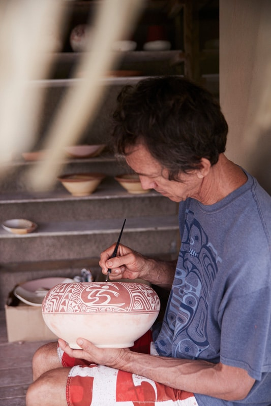 Peter Owen painting a Polynesian Pottery