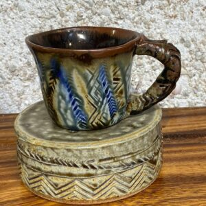 Small hand made porcelain mug with Polynesian tattoo designs and the unique Huahine blue and yellow glazes. All of our mugs become a very personal part of your daily coffee or tea ritual.