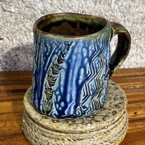 Porcelain mug with relief designs