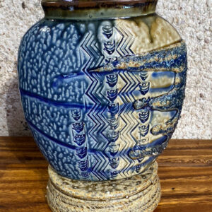 This oval porcelain vase is decorated on two sides with beautiful relief designs