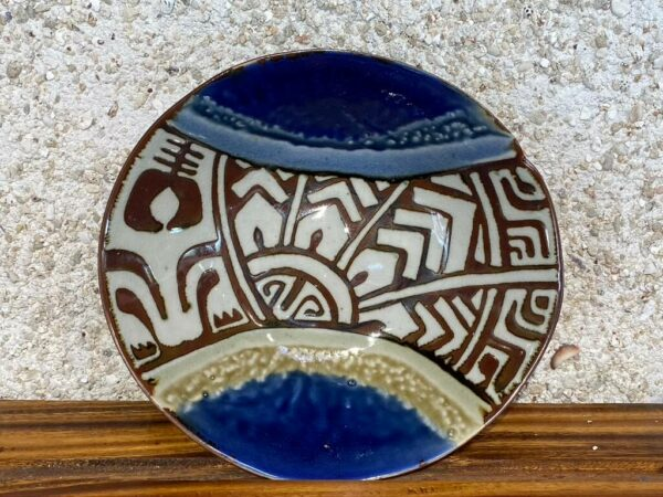 Medium bowl hand decorated with Polynesian tattoo designs glazed in white with green and blue Huahine glazes